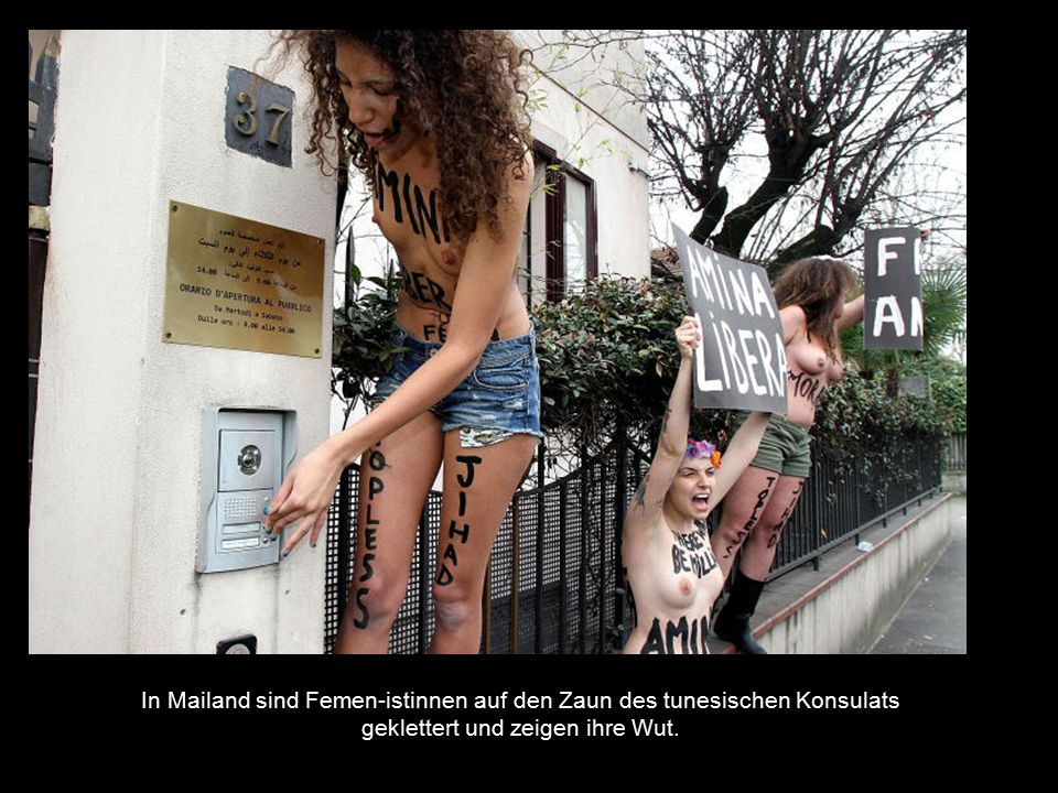 In Mailand sind Femen-istinnen auf den Zaun des tunesischen Konsulats geklettert und zeigen ihre Wut.