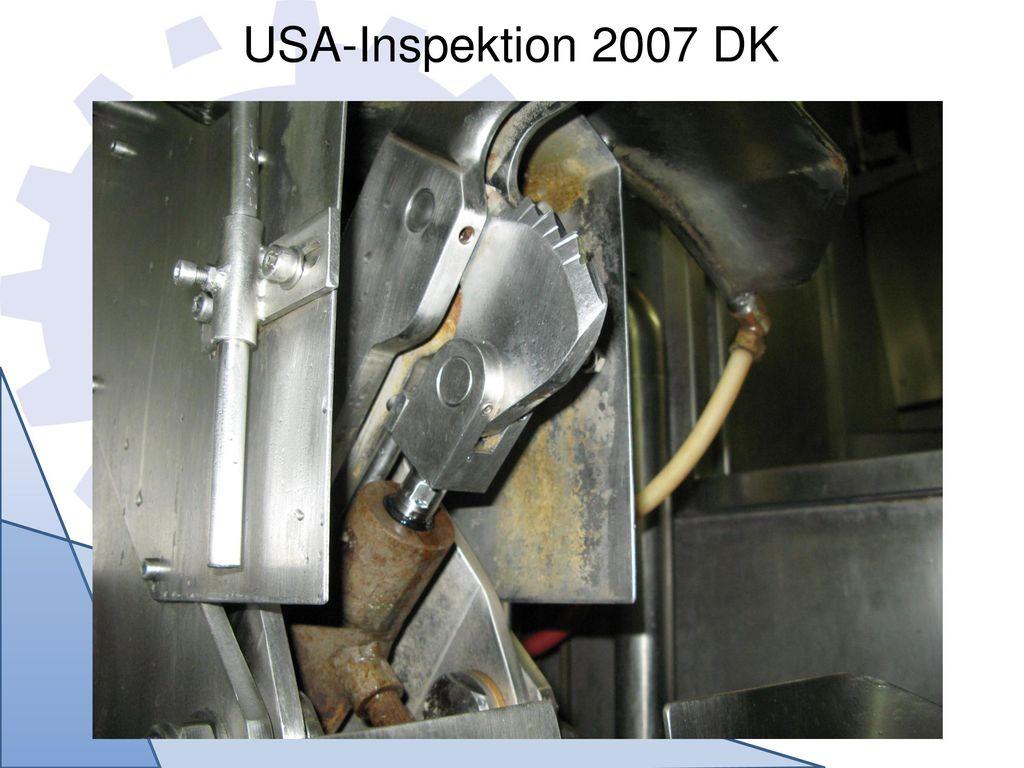 USA-Inspektion 2007 DK Produktreste auf der Spaltsäge sowie Belage auf der Schirminnenseite – produktberührende Oberfläche.