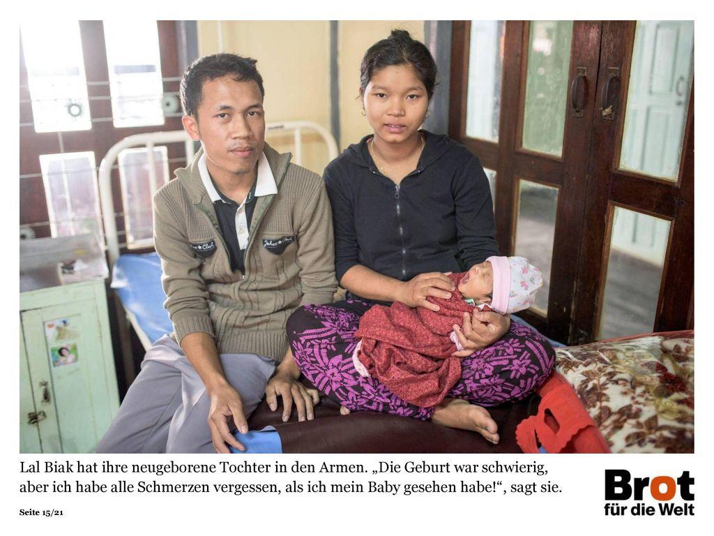 Lal Biak hat ihre neugeborene Tochter in den Armen