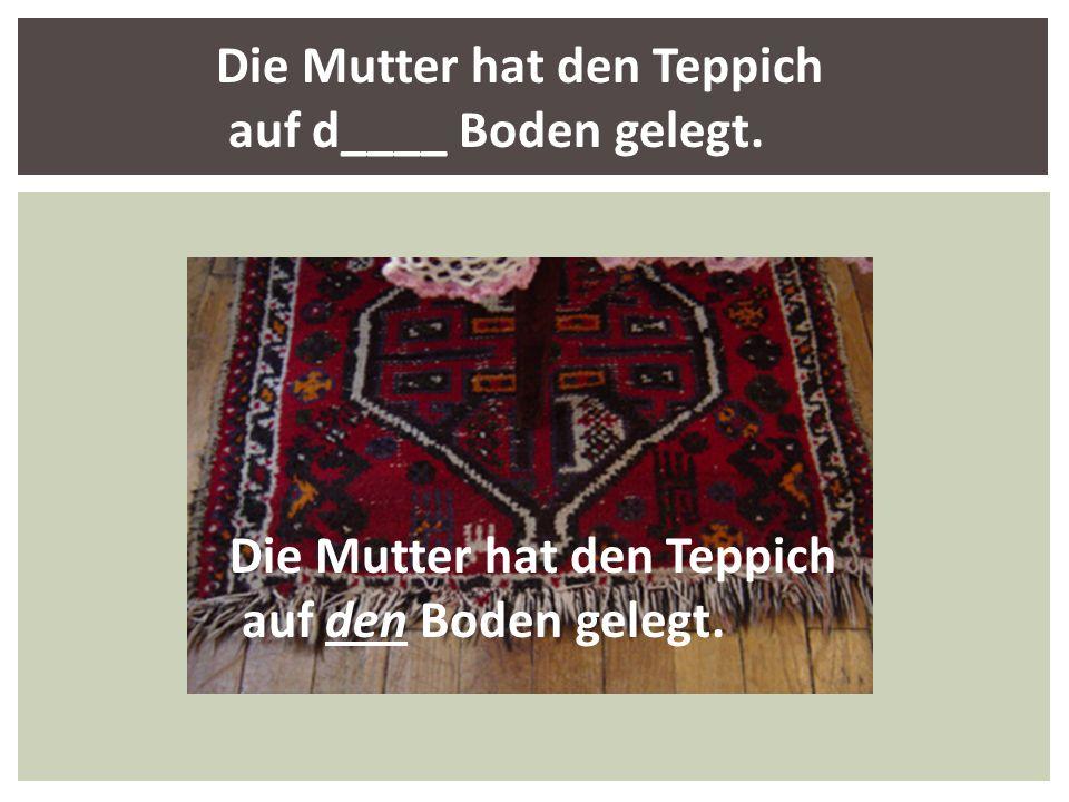 Die Mutter hat den Teppich