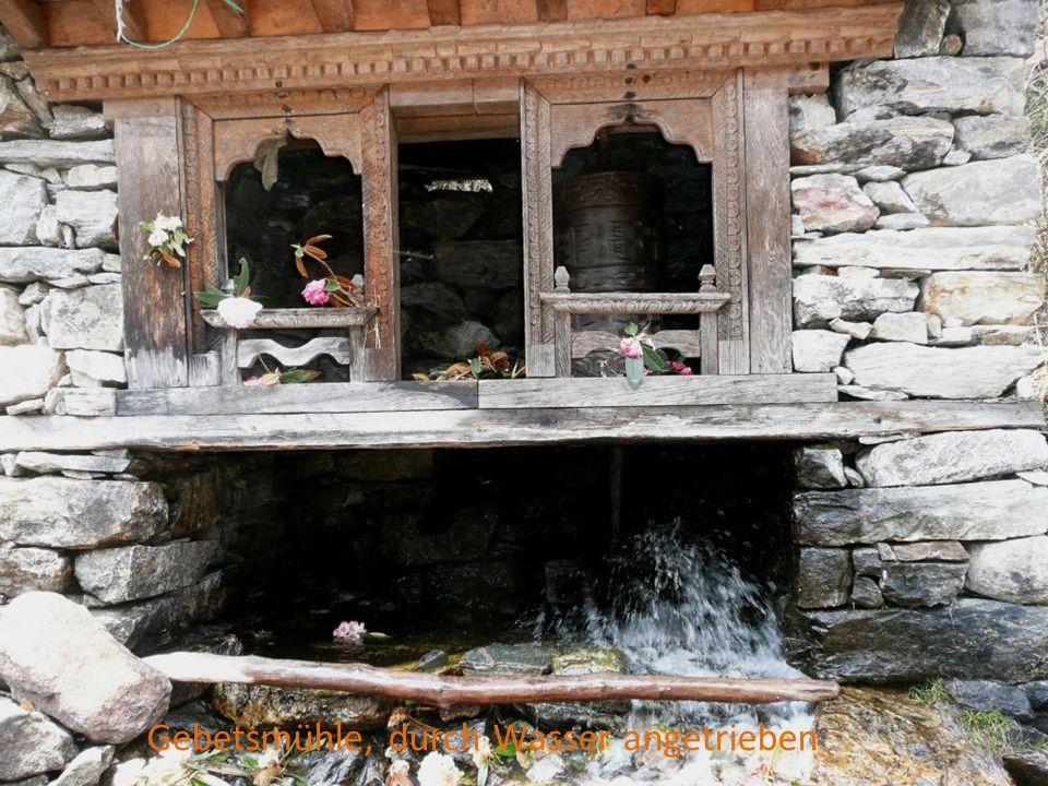 Gebetsmühle, durch Wasser angetrieben