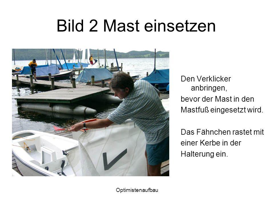 Bild 2 Mast einsetzen Den Verklicker anbringen, bevor der Mast in den