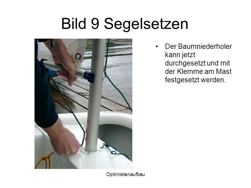Bild 9 Segelsetzen Der Baumniederholer kann jetzt durchgesetzt und mit der Klemme am Mast festgesetzt werden.