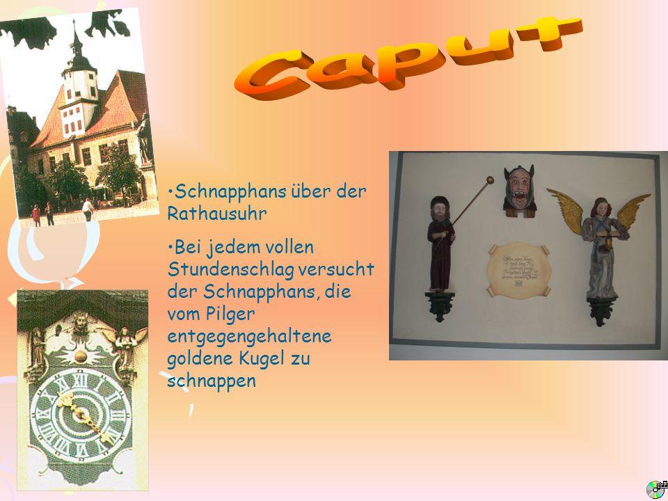 Caput Schnapphans über der Rathausuhr