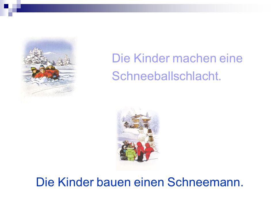 Die Kinder bauen einen Schneemann.