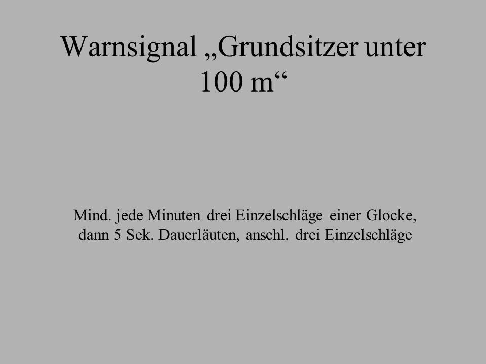 """Warnsignal """"Grundsitzer unter 100 m"""