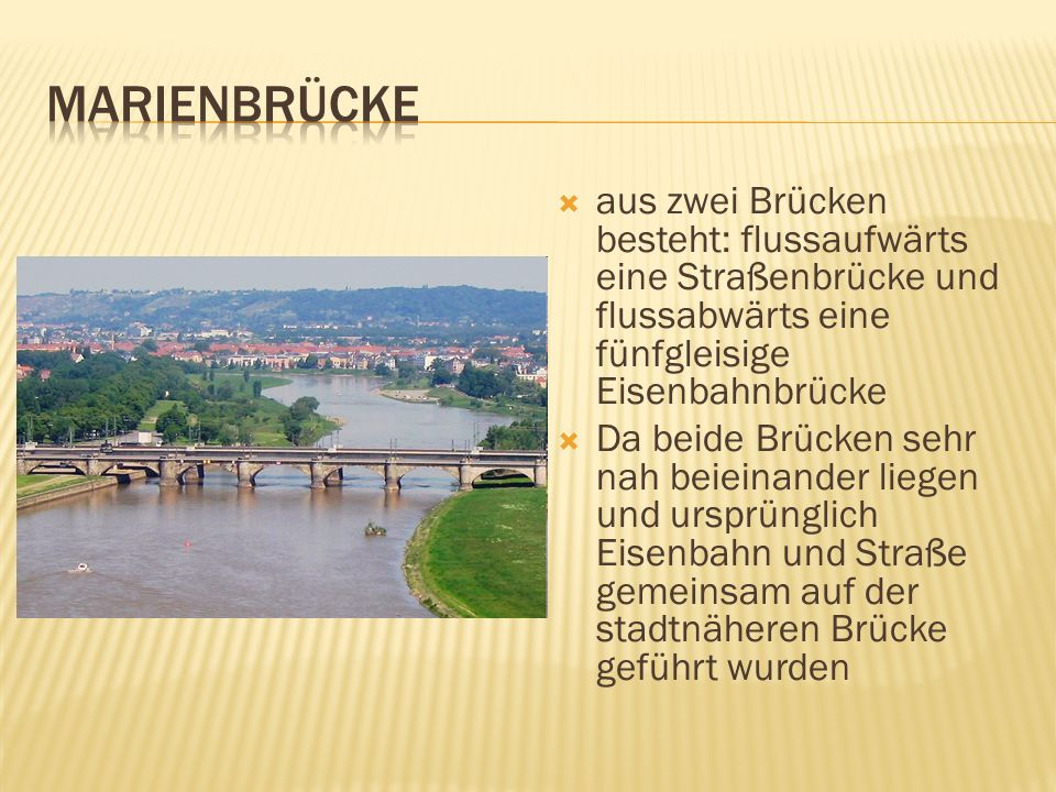 Marienbrücke aus zwei Brücken besteht: flussaufwärts eine Straßenbrücke und flussabwärts eine fünfgleisige Eisenbahnbrücke.