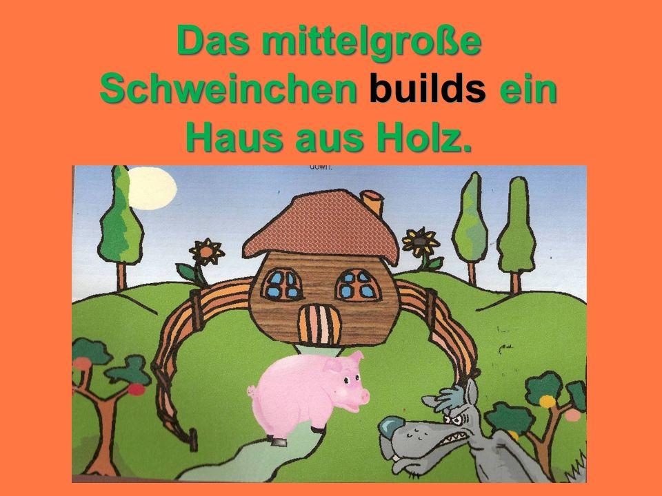 Das mittelgroße Schweinchen builds ein Haus aus Holz.