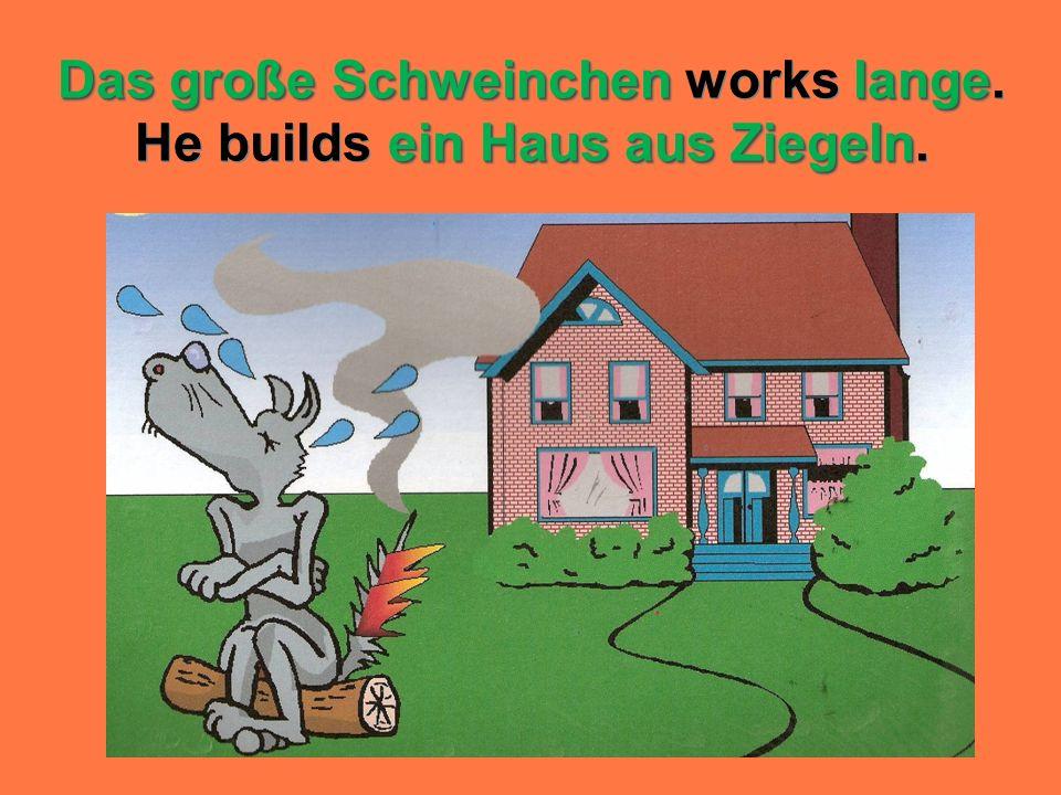 Das große Schweinchen works lange. He builds ein Haus aus Ziegeln.