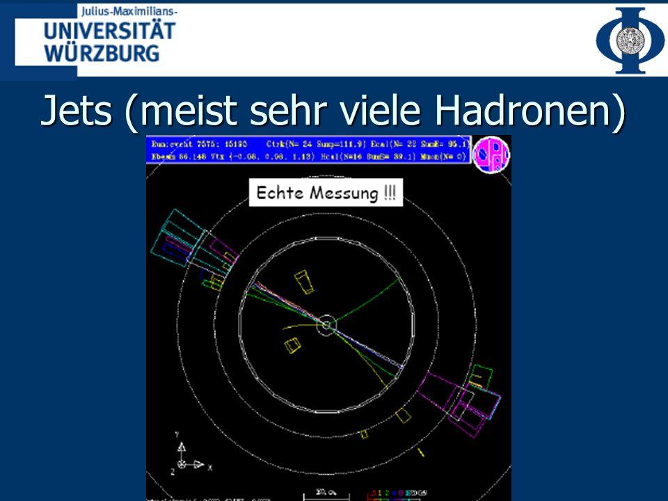 Jets (meist sehr viele Hadronen)