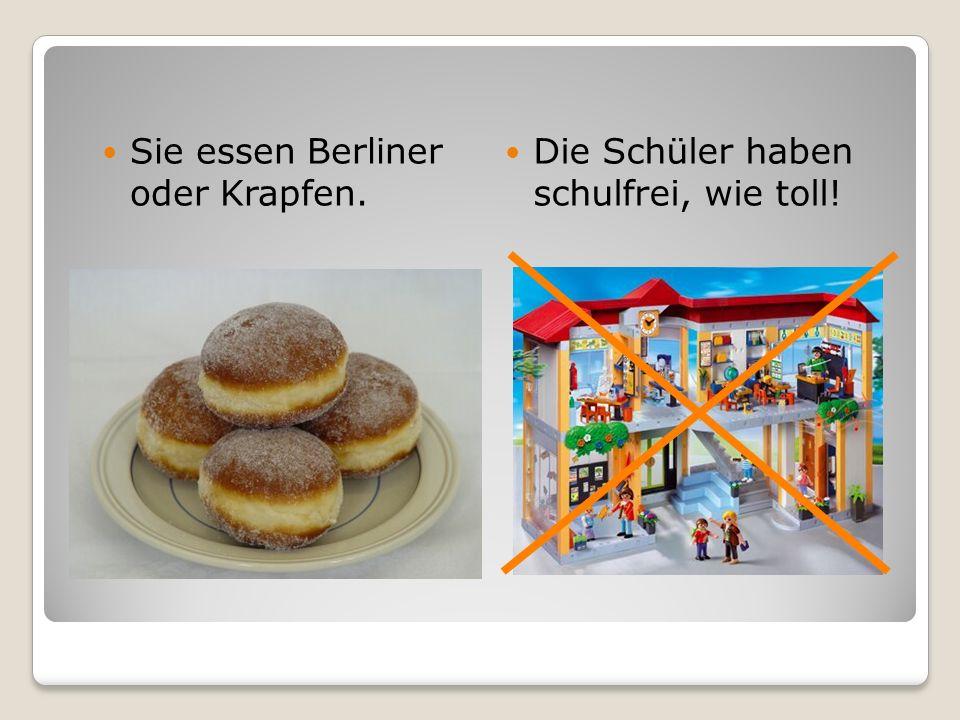 Sie essen Berliner oder Krapfen.