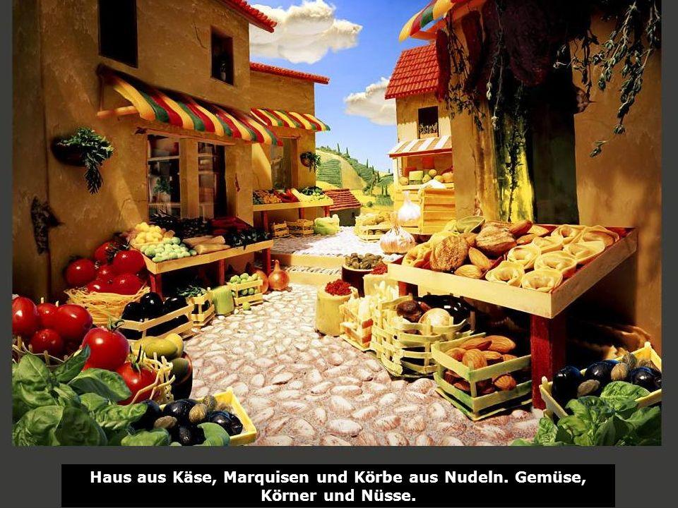 Haus aus Käse, Marquisen und Körbe aus Nudeln. Gemüse, Körner und Nüsse.