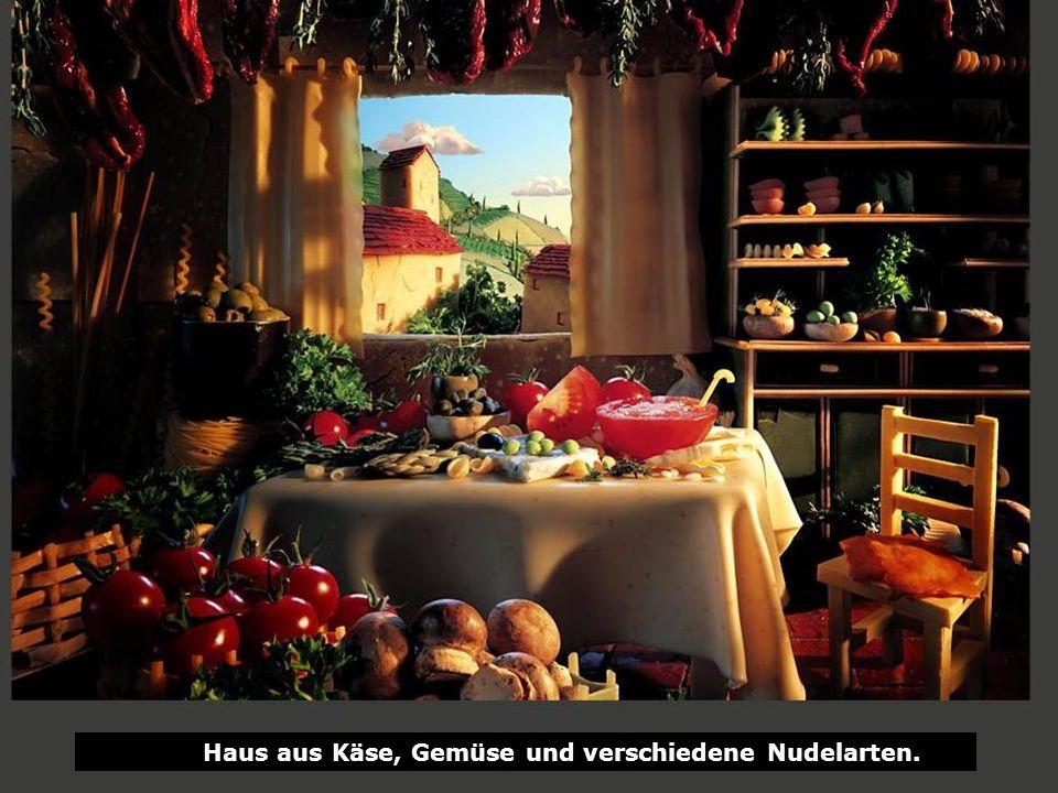 Haus aus Käse, Gemüse und verschiedene Nudelarten.