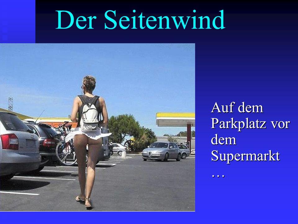 Der Seitenwind Auf dem Parkplatz vor dem Supermarkt …