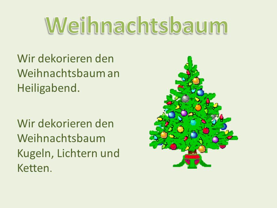 Weihnachtsbaum Wir dekorieren den Weihnachtsbaum an Heiligabend.