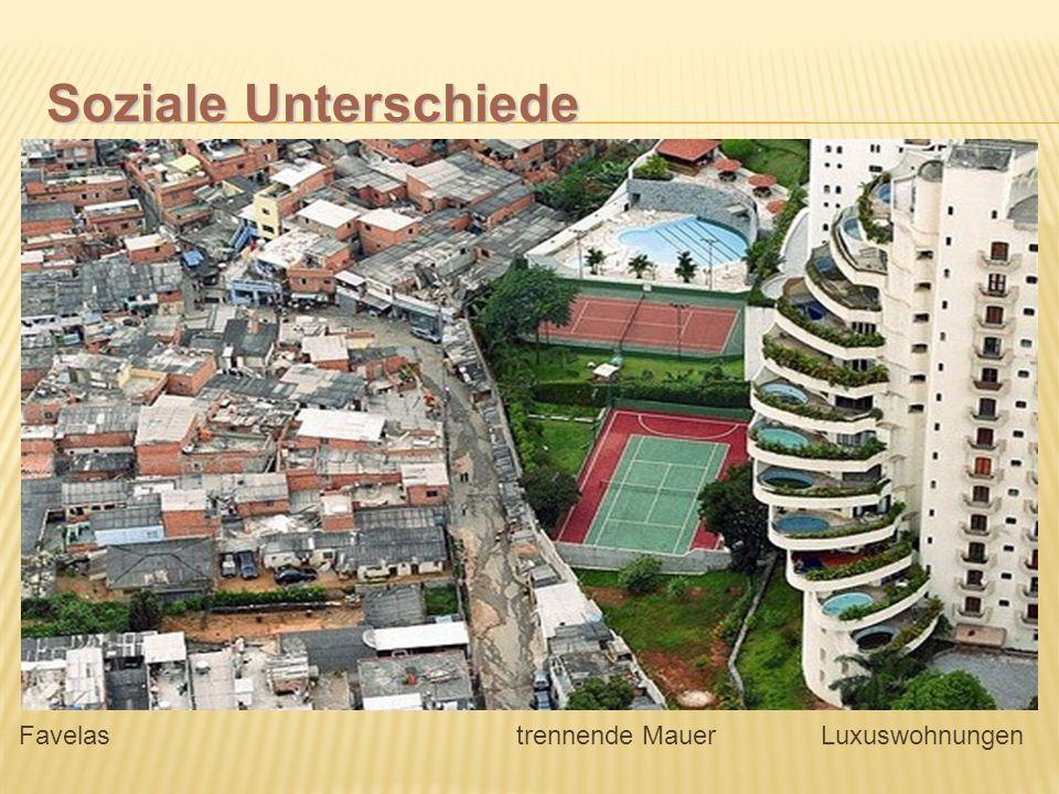 Soziale Unterschiede Favelas trennende Mauer Luxuswohnungen.