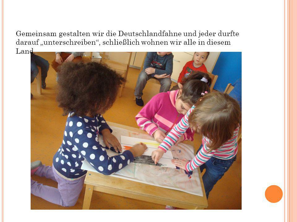 """Gemeinsam gestalten wir die Deutschlandfahne und jeder durfte darauf """"unterschreiben , schließlich wohnen wir alle in diesem Land."""
