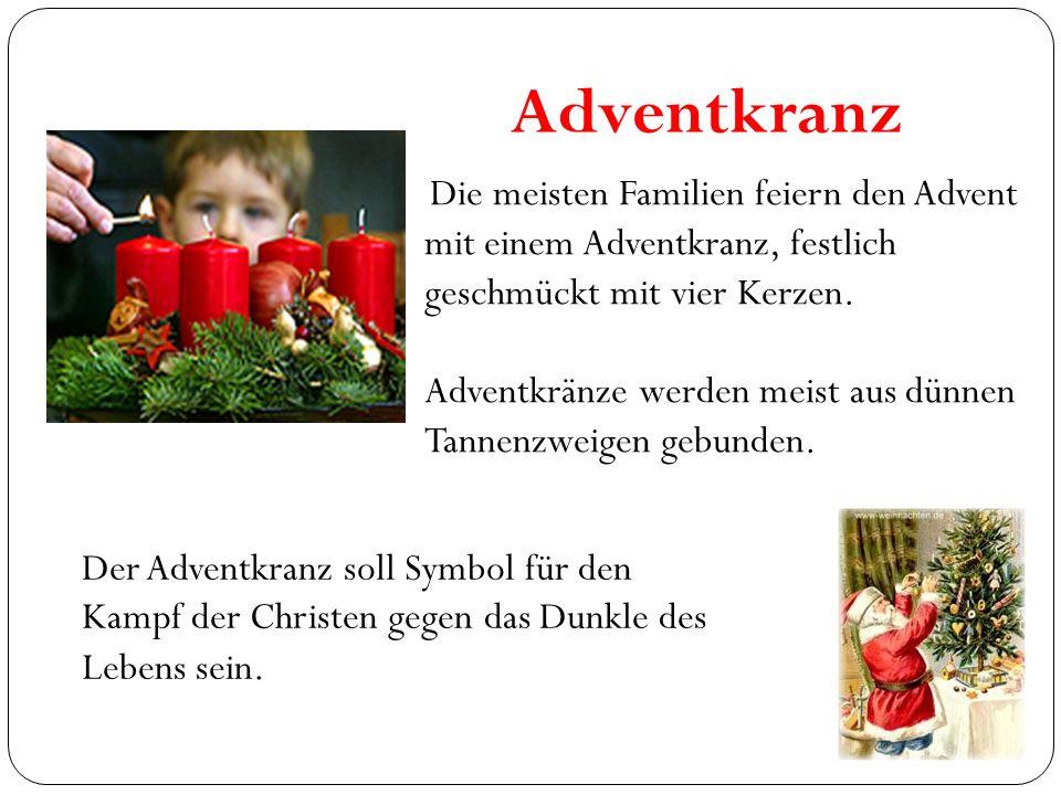 Adventkranz Die meisten Familien feiern den Advent mit einem Adventkranz, festlich geschmückt mit vier Kerzen.