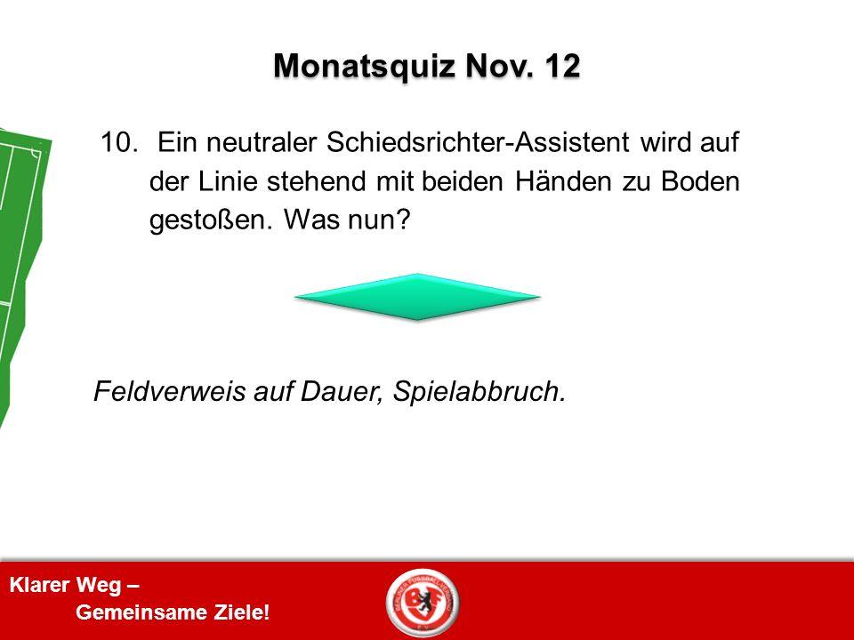 Monatsquiz Nov. 12 10. Ein neutraler Schiedsrichter-Assistent wird auf der Linie stehend mit beiden Händen zu Boden gestoßen. Was nun
