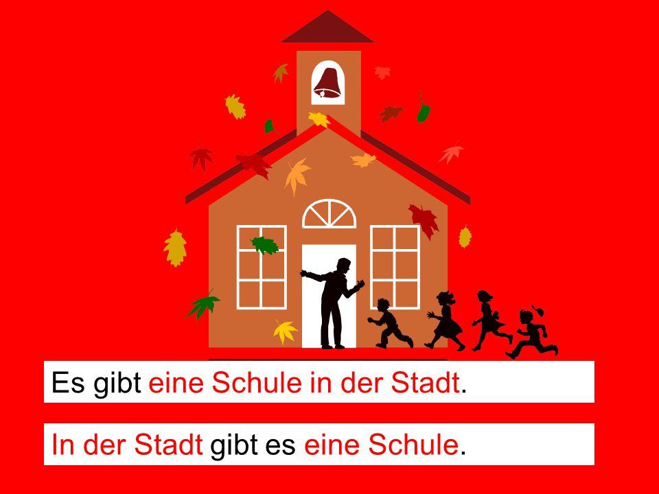 Es gibt eine Schule in der Stadt.