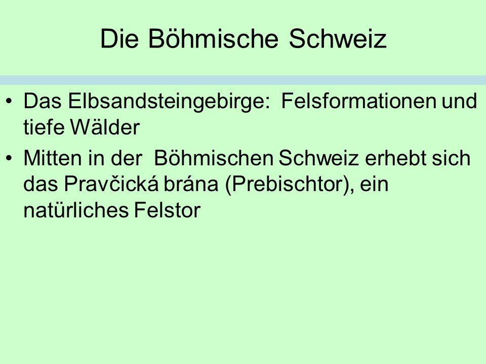Die Böhmische Schweiz Das Elbsandsteingebirge: Felsformationen und tiefe Wälder.