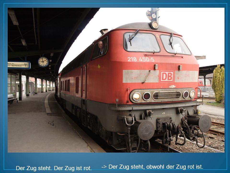 Der Zug steht. Der Zug ist rot.