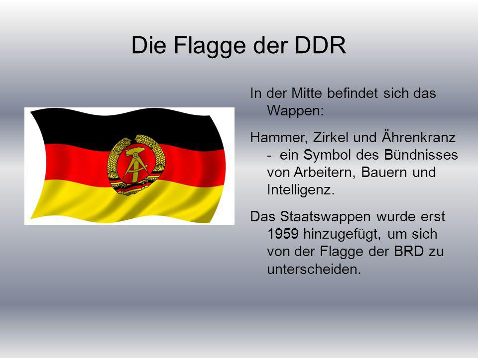 Die Flagge der DDR In der Mitte befindet sich das Wappen:
