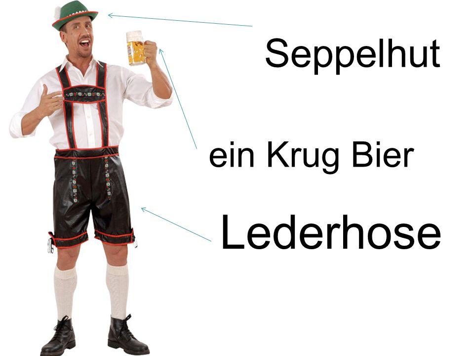 Seppelhut ein Krug Bier Lederhose