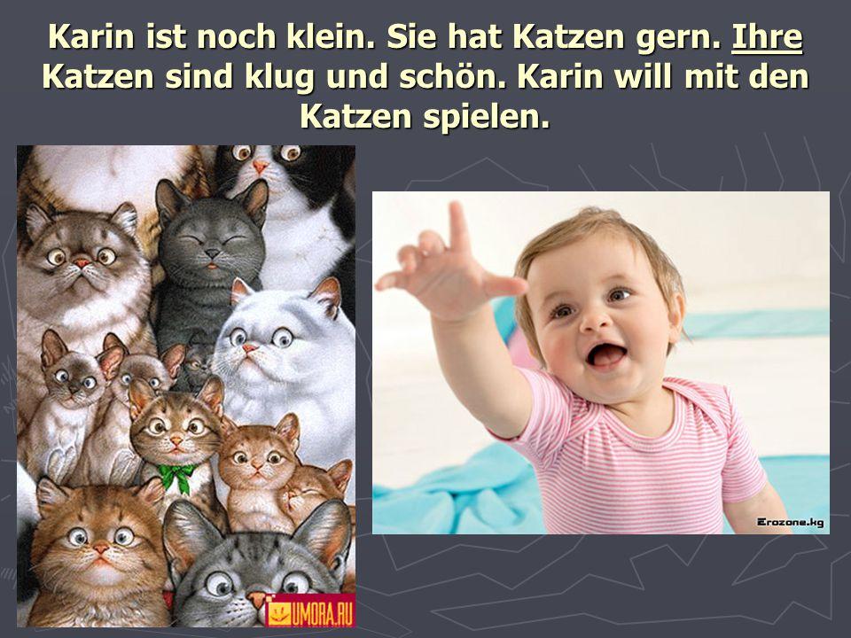 Karin ist noch klein. Sie hat Katzen gern