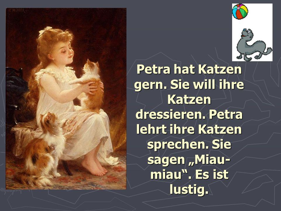 Petra hat Katzen gern. Sie will ihre Katzen dressieren