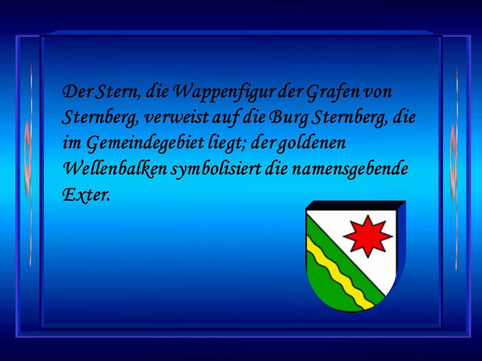 Der Stern, die Wappenfigur der Grafen von Sternberg, verweist auf die Burg Sternberg, die im Gemeindegebiet liegt; der goldenen Wellenbalken symbolisiert die namensgebende Exter.