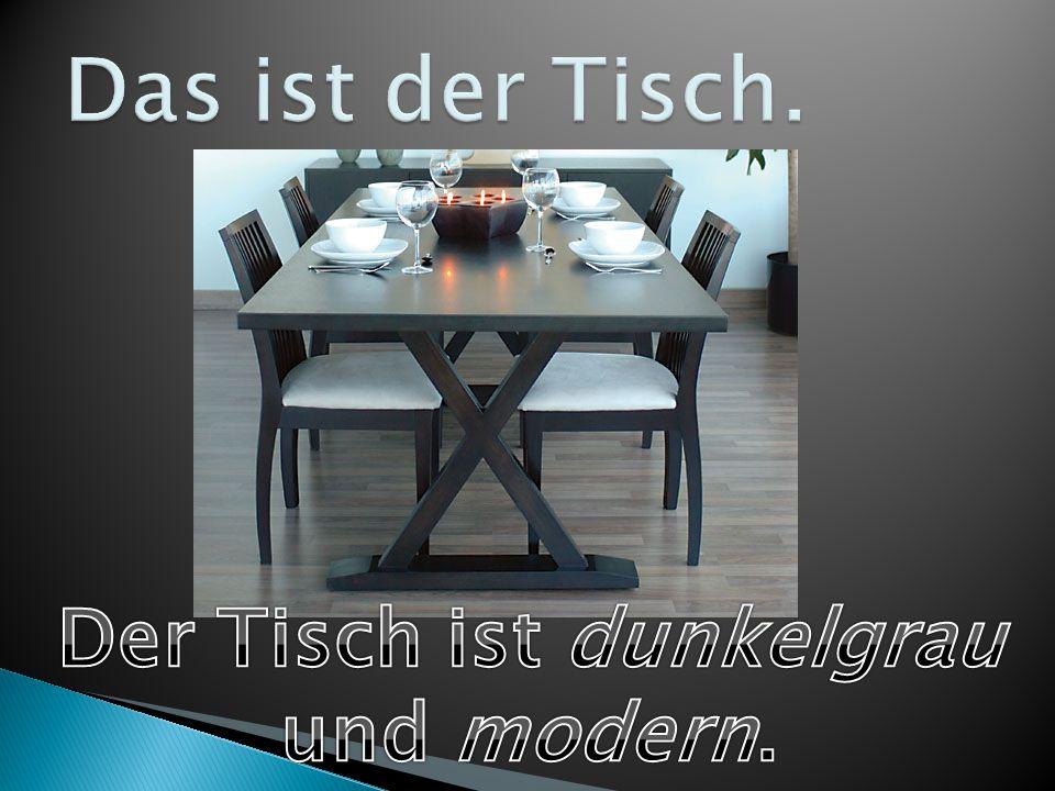Der Tisch ist dunkelgrau und modern.