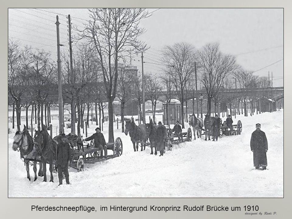 Pferdeschneepflüge, im Hintergrund Kronprinz Rudolf Brücke um 1910