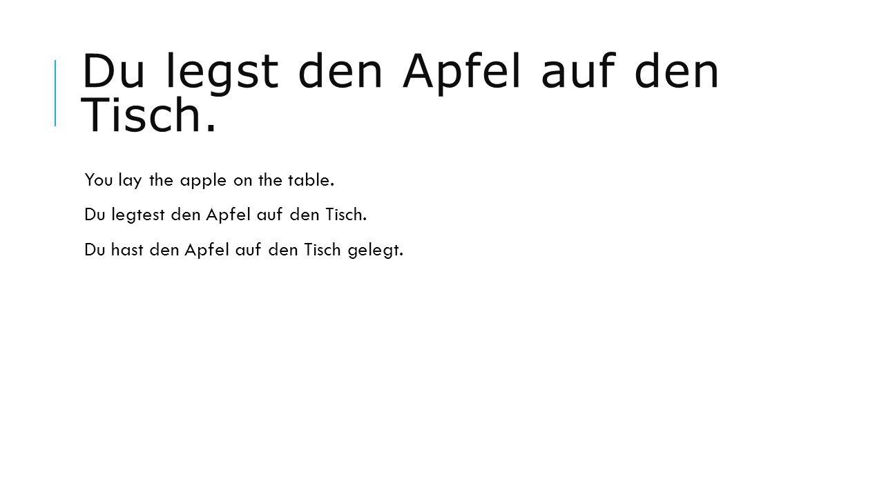 Du legst den Apfel auf den Tisch.