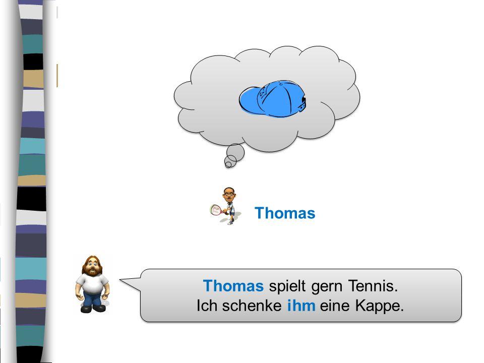 Thomas spielt gern Tennis. Ich schenke ihm eine Kappe.