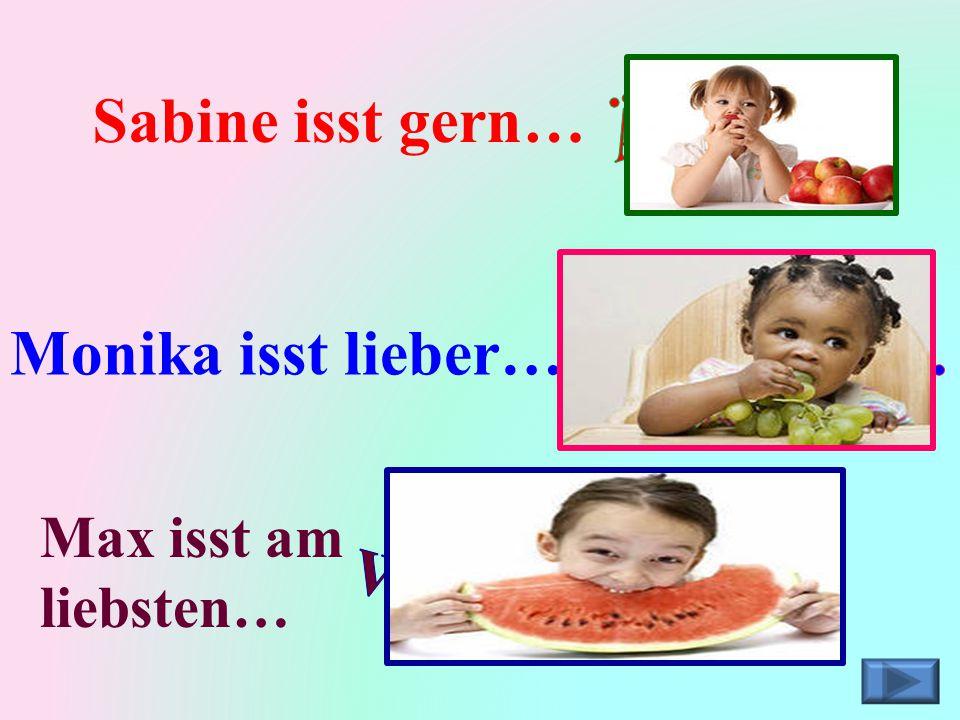 Äpfel. Sabine isst gern… Monika isst lieber… Weintrauben.