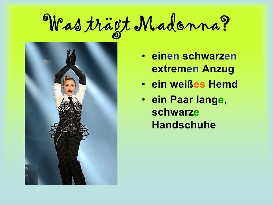 Was trägt Madonna einen schwarzen extremen Anzug ein weißes Hemd