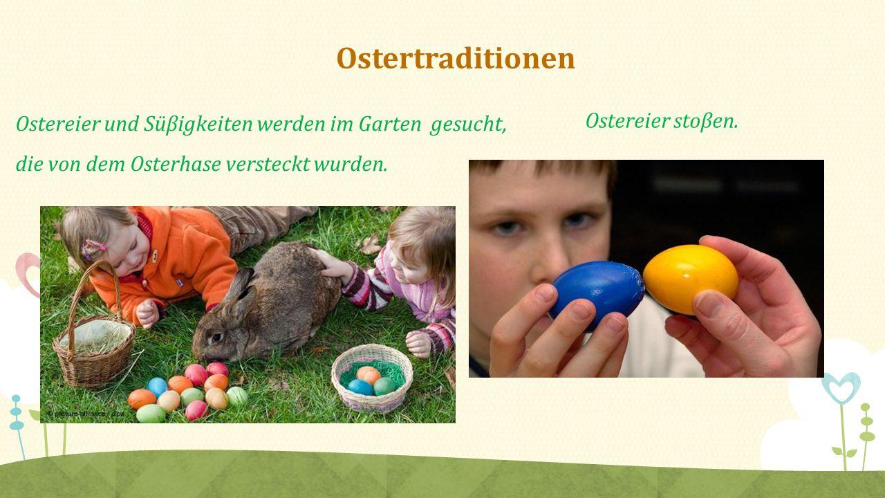 Ostertraditionen Ostereier und Süβigkeiten werden im Garten gesucht, die von dem Osterhase versteckt wurden.