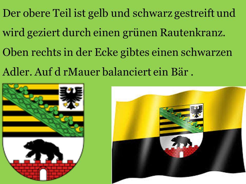 Der obere Teil ist gelb und schwarz gestreift und wird geziert durch einen grünen Rautenkranz.