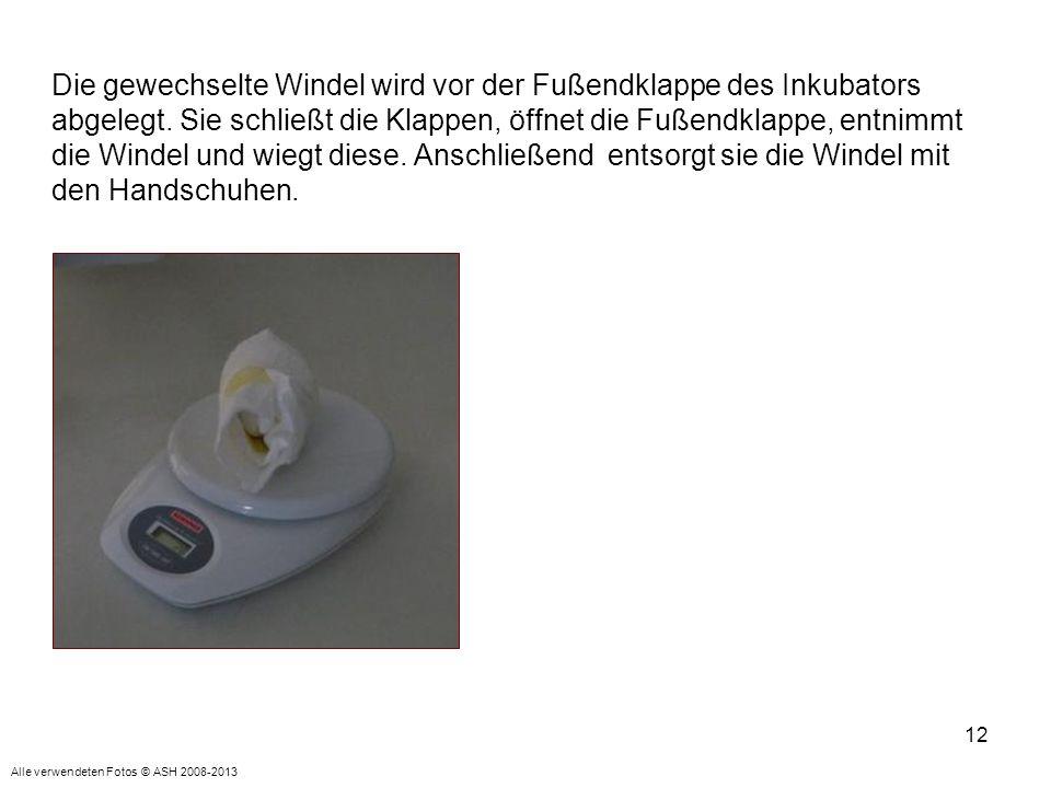 Die gewechselte Windel wird vor der Fußendklappe des Inkubators abgelegt. Sie schließt die Klappen, öffnet die Fußendklappe, entnimmt die Windel und wiegt diese. Anschließend entsorgt sie die Windel mit den Handschuhen.
