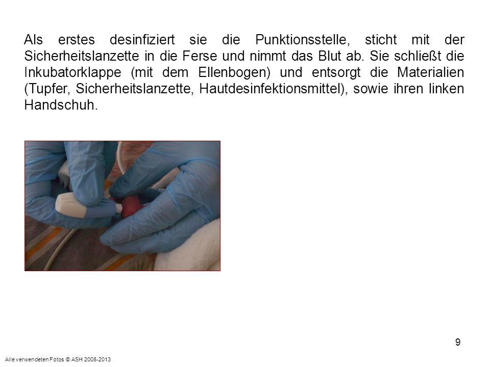 Als erstes desinfiziert sie die Punktionsstelle, sticht mit der Sicherheitslanzette in die Ferse und nimmt das Blut ab. Sie schließt die Inkubatorklappe (mit dem Ellenbogen) und entsorgt die Materialien (Tupfer, Sicherheitslanzette, Hautdesinfektionsmittel), sowie ihren linken Handschuh.