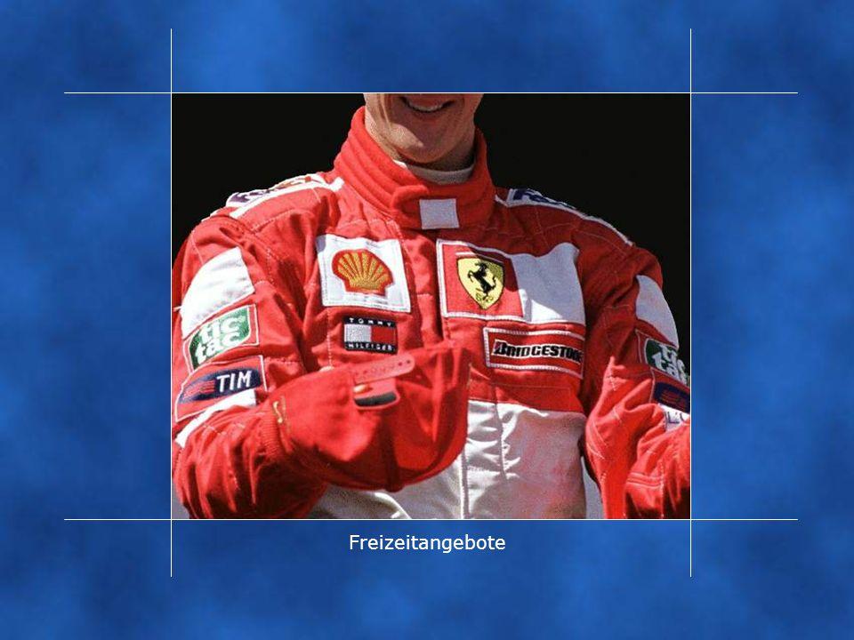 ... das Siegerlächeln eines Michael Schumachers, das nur noch von der Buntheit der unzähligen Logos auf seinem Rennanzug überstrahlt wird.