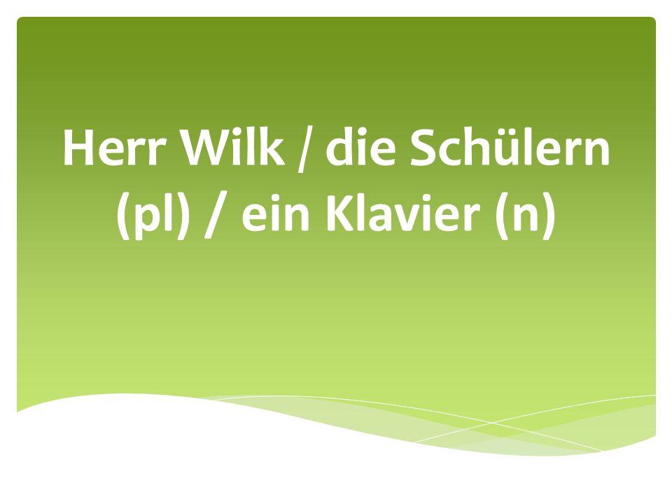Herr Wilk / die Schülern (pl) / ein Klavier (n)