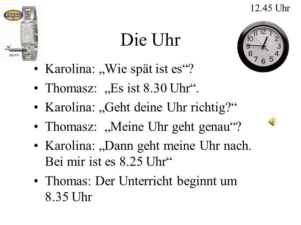 """Die Uhr Karolina: """"Wie spät ist es Thomasz: """"Es ist 8.30 Uhr ."""