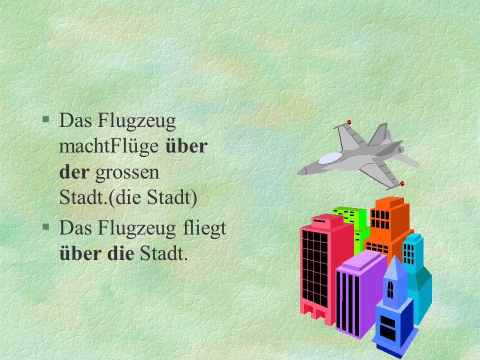 Das Flugzeug machtFlüge über der grossen Stadt.(die Stadt)
