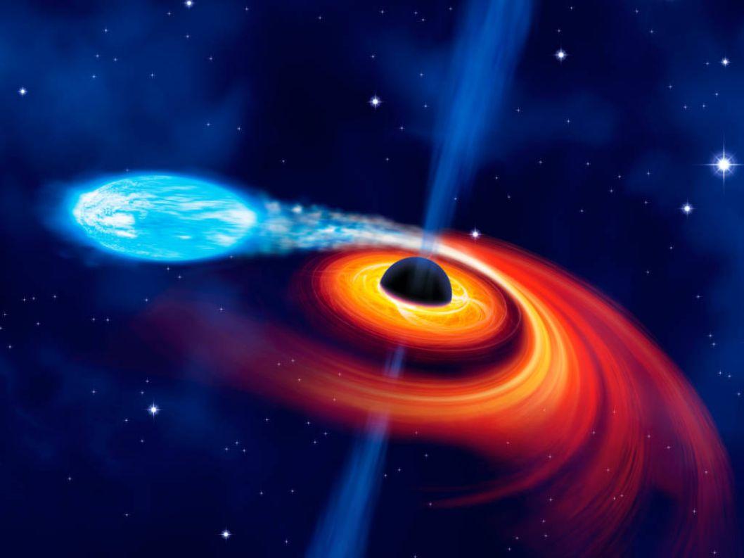 Ein Stern wird von der Schwerkraft eines Schwarzen Loches zerissen.