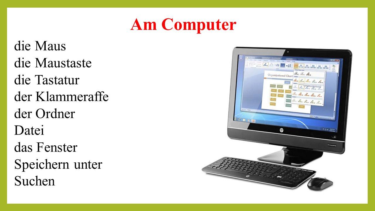 Am Computer die Maus die Maustaste die Tastatur der Klammeraffe