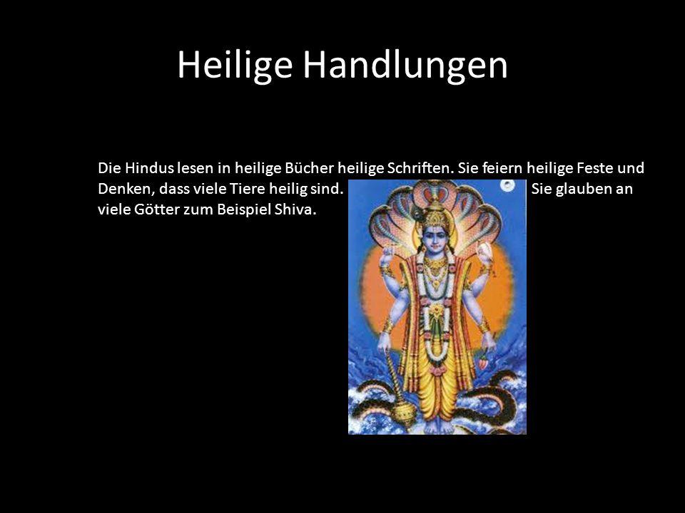 Heilige Handlungen Die Hindus lesen in heilige Bücher heilige Schriften. Sie feiern heilige Feste und.