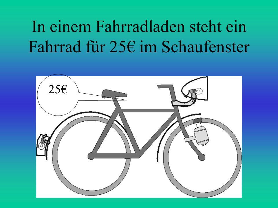 In einem Fahrradladen steht ein Fahrrad für 25€ im Schaufenster