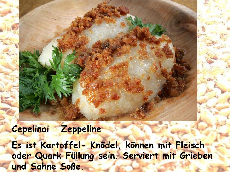 Cepelinai – Zeppeline Es ist Kartoffel- Knödel, können mit Fleisch oder Quark Füllung sein.